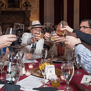 Los Angeles Murder Mystery guests raise glasses