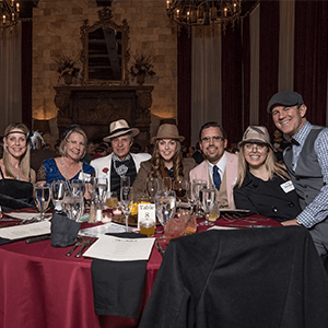Los Angeles Murder Mystery party guests at the table