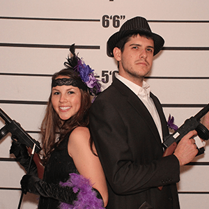 Los Angeles Murder Mystery party guests pose for mugshots